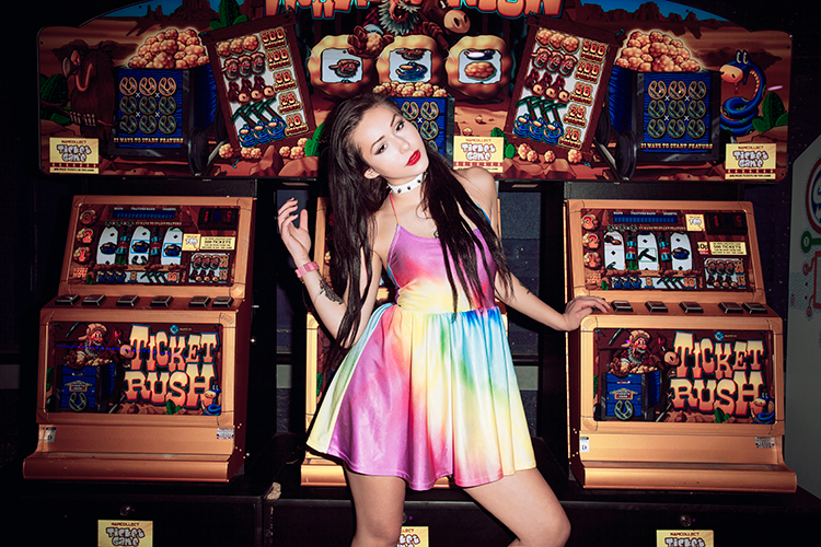 @_hannahdaisy wears Jennifer Hope Clothing in an arcade